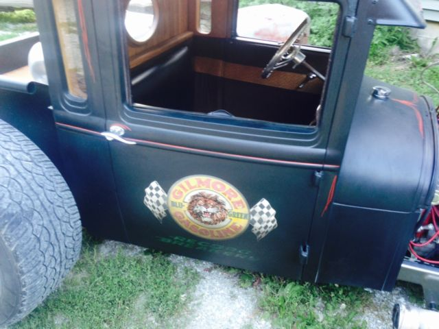 1931 model a pickup  flat black  extended cab  chopped top