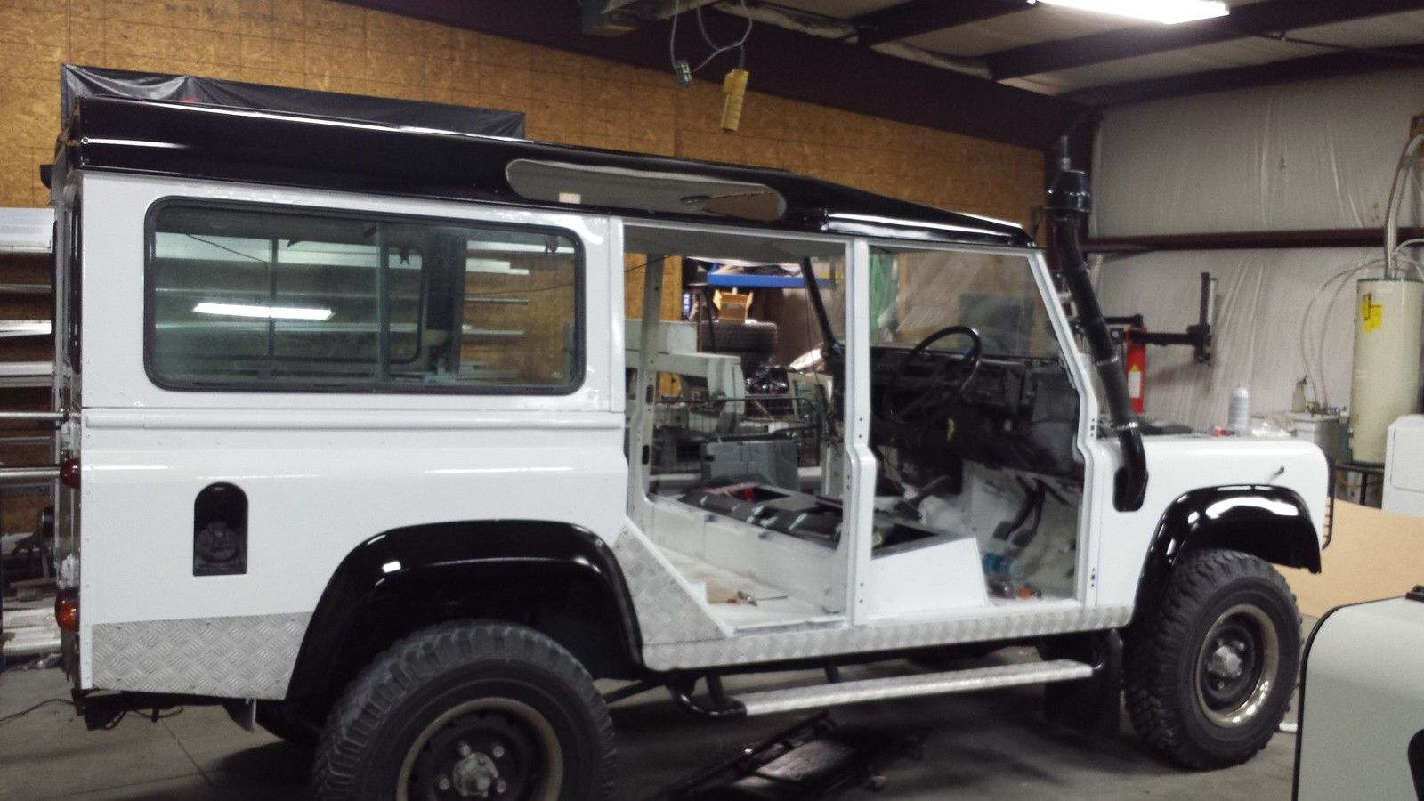 Land Rover Defender 110 with a nice restoration. Diesel, manual, like new