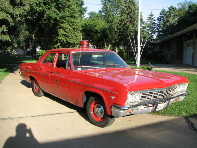 nice bel air dolled up as a fire chief car. Black Bedroom Furniture Sets. Home Design Ideas